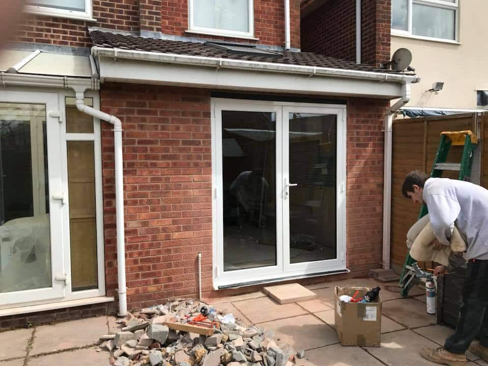 Kitchen extension with new French doors.   North West Bifolds on